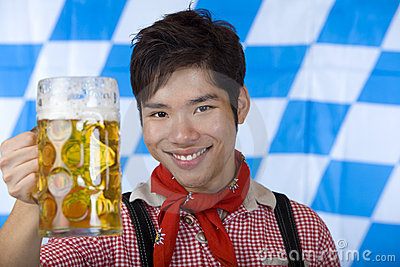 Man cheers with Oktoberfest beer stein (Mass)