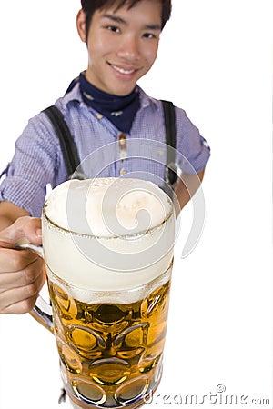Man cheers with Oktoberfest beer stein (Mass)