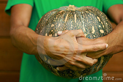Man chef holding pumpkin
