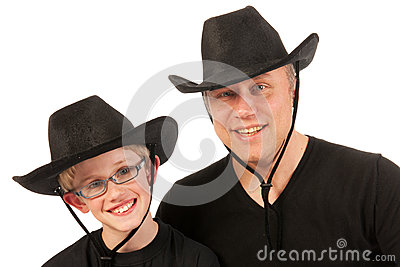 Man and child with cowboy hats