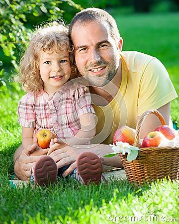 Man and child having picnic