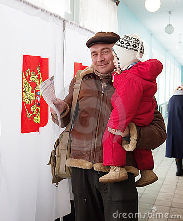 Man with child votes in Russian  election