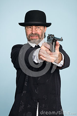 Man in chinese suit shoots a gun