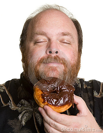 Man with chocolate donut