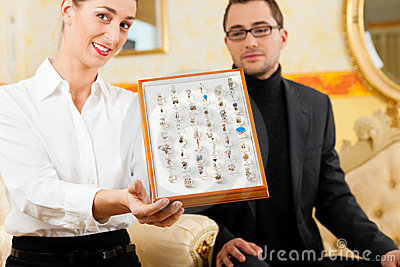 Man choosing a ring at the jeweller