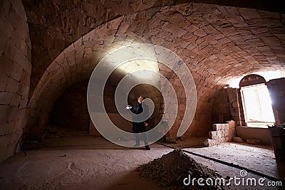 Man in church crypt