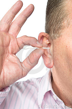 Man cleaning ear with cotton swab