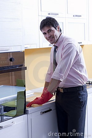 Man Cleaning Kitchen Counter Royalty Free Stock