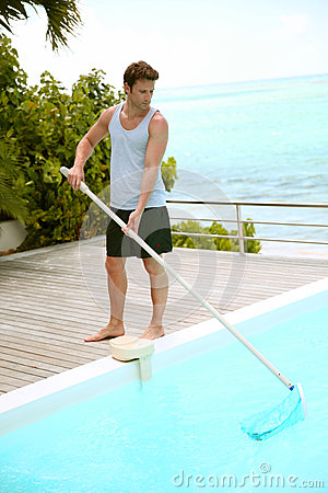 Man cleaning private pool