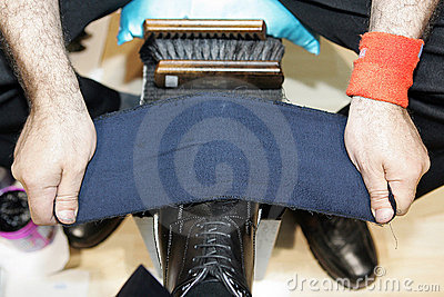 Man cleaning shoes