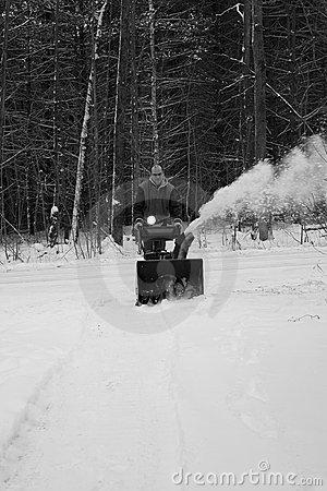 Man Clearing Driveway with Snow Blower
