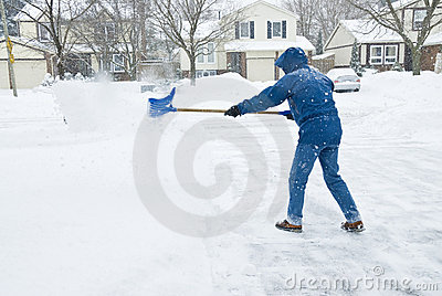 Man Clearing Snow in the Driveway