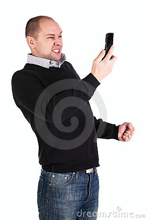 Man with clenched fist and mobile phone