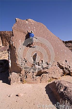 Man climbing boulder