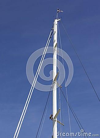 Man climbing a high mast