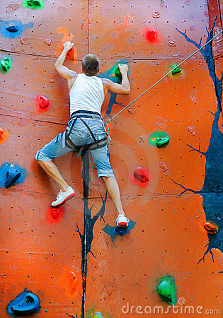 Free Man Climbing On A Climbing Wall Stock Image - 21460331
