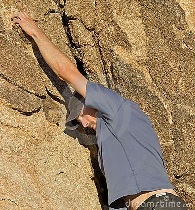 Man climbing a rock wall