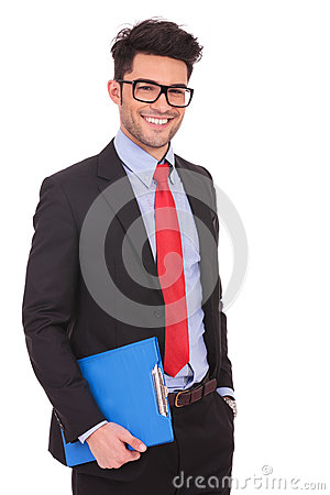 Man with clipboard & hand in pocket