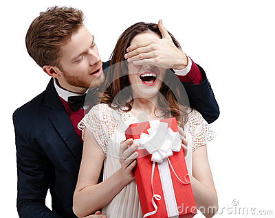 Man closes eyes of his girlfriend
