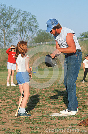 A man coaching a girl Editorial Image