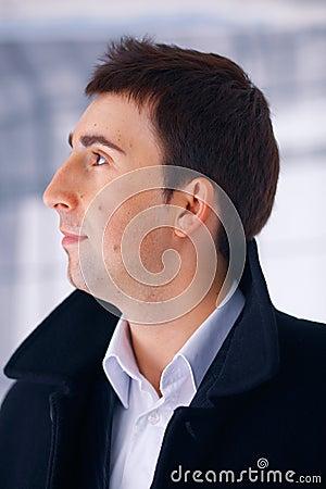 Man in Coat Looking Away.