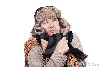 Man with cold wearing a scarf and a bonnet