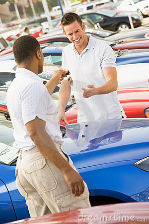 Man collecting new car