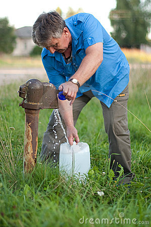 A man collects the water from