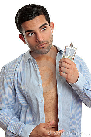Man with cologne while dressing