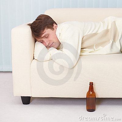 Man comfortable sleeps on sofa having got drunk