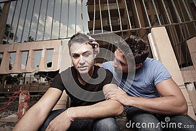 Man comforting his boyfriend
