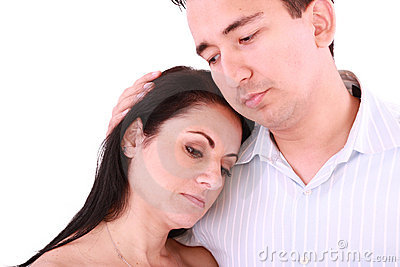 Man comforts woman.