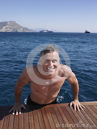 Free Man Coming Out Of Water On Yacht S Floorboard Royalty Free Stock Photography - 33903987