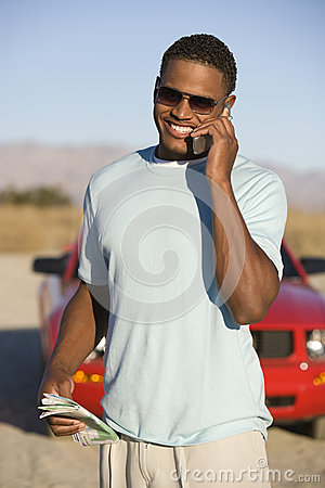 Man Communicating On Mobile Phone
