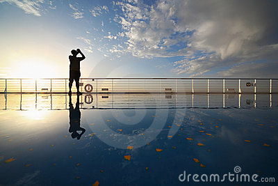 Man with compact photo camera shooting morning sky
