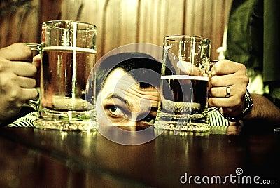 Man comparing beer mugs