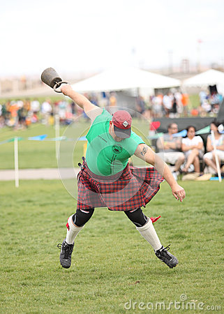 Man Competes in Weight Toss Editorial Photography