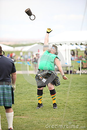 Man Competes in Weight Toss Editorial Photo