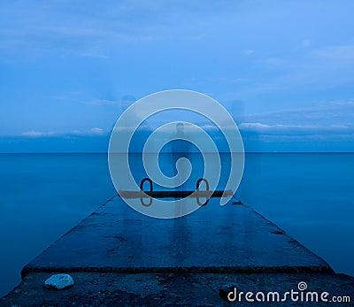Man and concrete pier