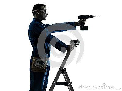 Man construction worker holding drill silhouette