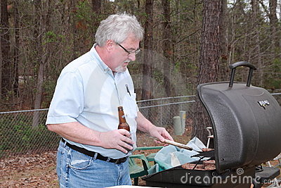 Man cooking with beer