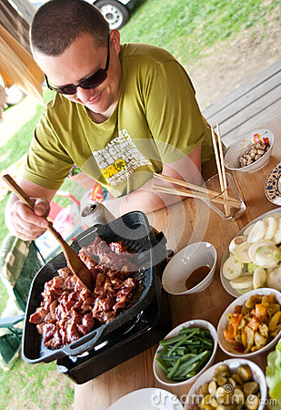 Man cooking outdoors