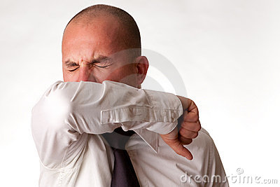 Man Coughing into Elbow