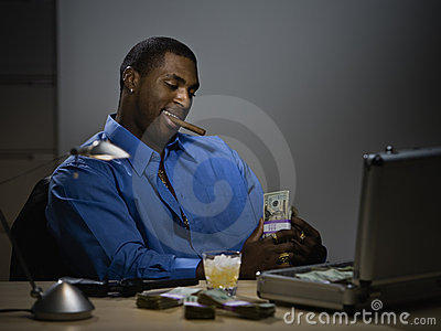 Man counting money at desk
