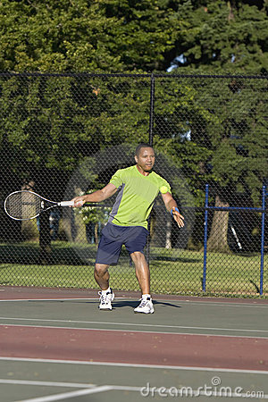 Man on Court Playing Tennis