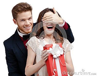 Man covers eyes of his girlfriend