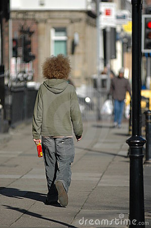 A man with a crazy red afro
