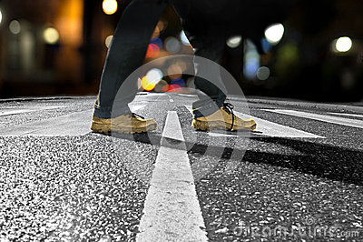 Man crossing street at night