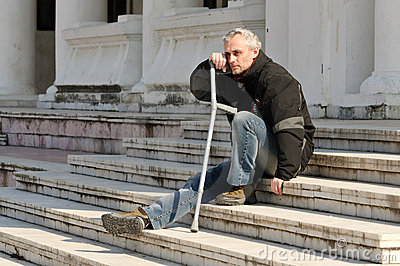 Man with crutch outdoor
