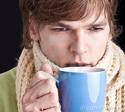 Man with cup of tea of coffee